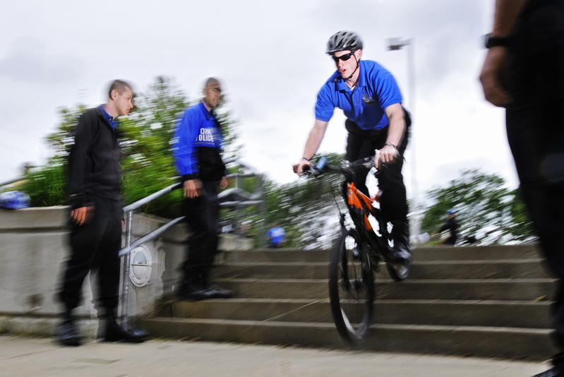 Ben Mitchell, a new reserve officer for the York Police Department, participates in a drill Tuesday at York Middle School designed to help officers ride their mountain bikes down stairs while chasing a suspect.