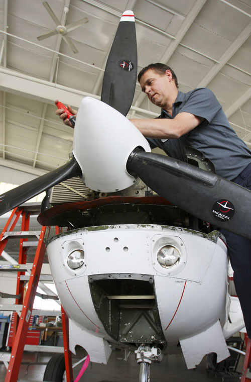 Aircraft mechanic Will Andrews of Windham works on a plane at Northeast Air in Portland today.