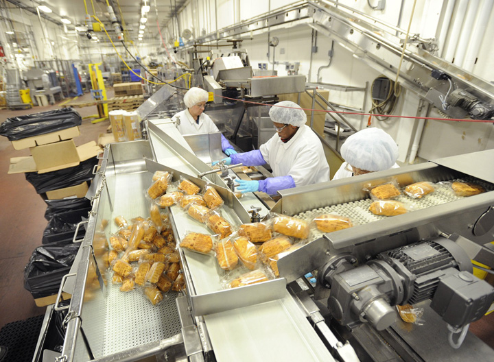 Barber Foods workers package stuffed chicken breasts in this December 2010 photo.