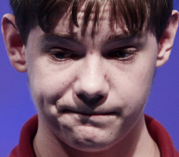 Tony Incorvati, 13, from Canton, Ohio, reacts after spelling