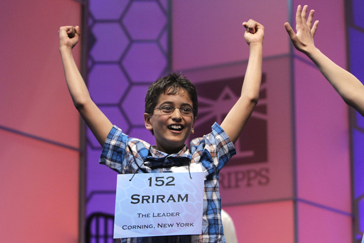 Sriram Jagadeesh Hathwar, 11, from Corning, N.Y., celebrates on being told that he made it into the final round of the National Spelling Bee.