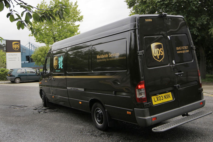 A UPS van arrives back at a depot in north London today. UPS told customers that some shipments from Britain were being delayed but would not say where those delayed packages were supposed to be heading.