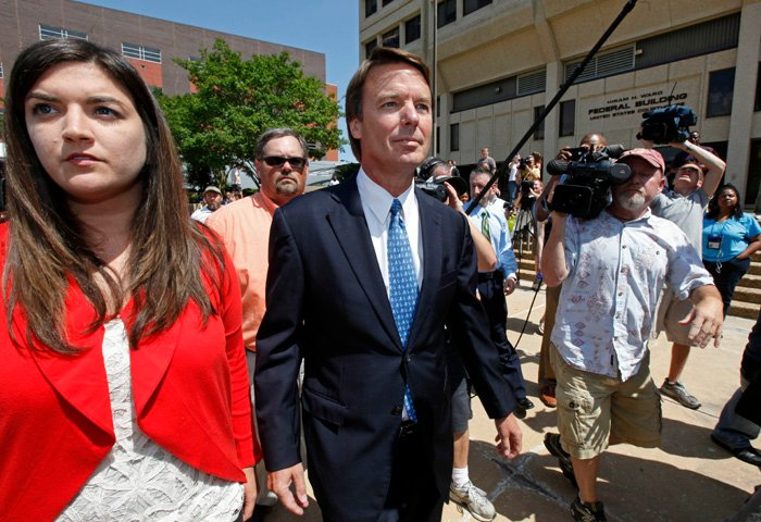 John Edwards, right, leaves the Federal Building with his daughter Cate Edwards, left, in Winston-Salem, N.C., today.