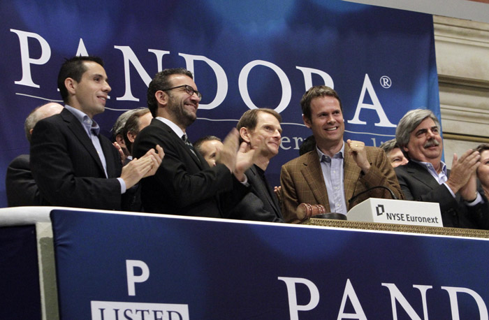 Pandora's CEO and President, Joe Kennedy, third from left, and Chief Strategy Officer & Founder Tim Westergren, fourth from left, ring the NYSE opening bell to celebrate their company's IPO at the New York Stock Exchange on Wednesday.