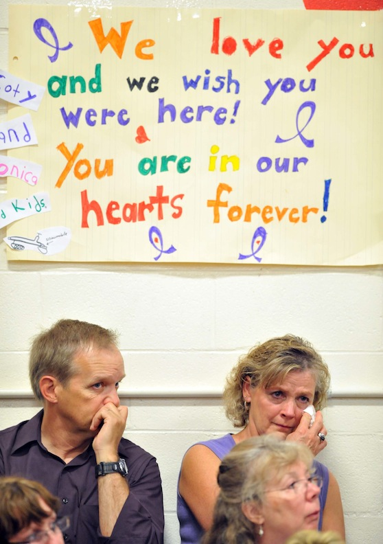 Signs of love and support decorate the walls of the Dexter Regional High School gymnasium during the funeral for Amy, Coty and Monica Lake in Dexter on Saturday.
