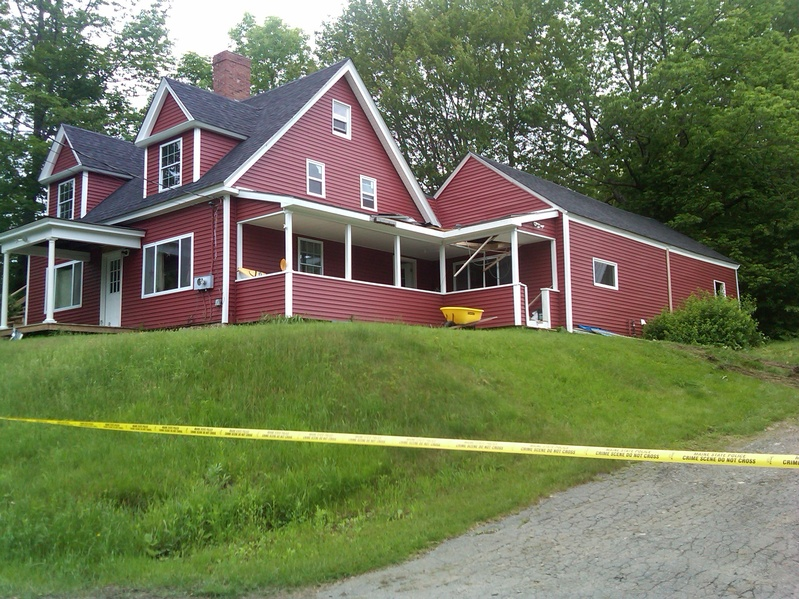 Police said they found the bodies of Steven and Amy Lake and their two children inside this home in Dexter on Monday, the apparent victims of a domestic-violence homicide.
