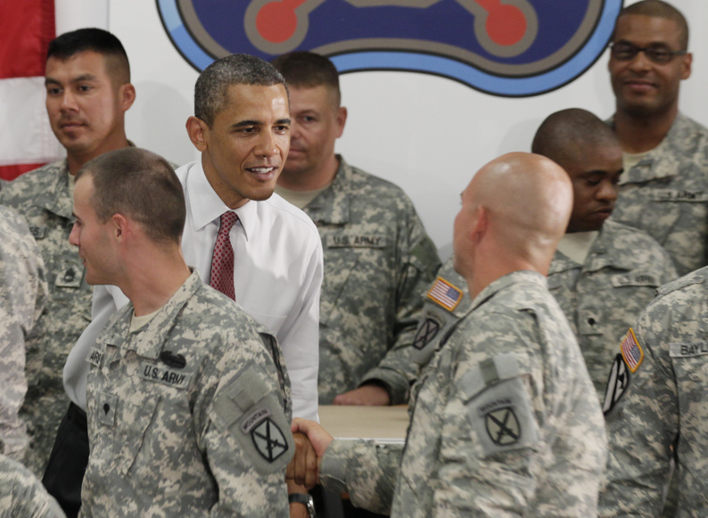 President Barack Obama visits with soldiers from the 10th Mountain Division, many of whom have just returned from Afghanistan, Thursday in Fort Drum, N.Y. On Wednesday, Obama announced the United States would begin a speedier withdrawal of troops than some of his generals would like, but not nearly fast enough for the war's growing number of critics.