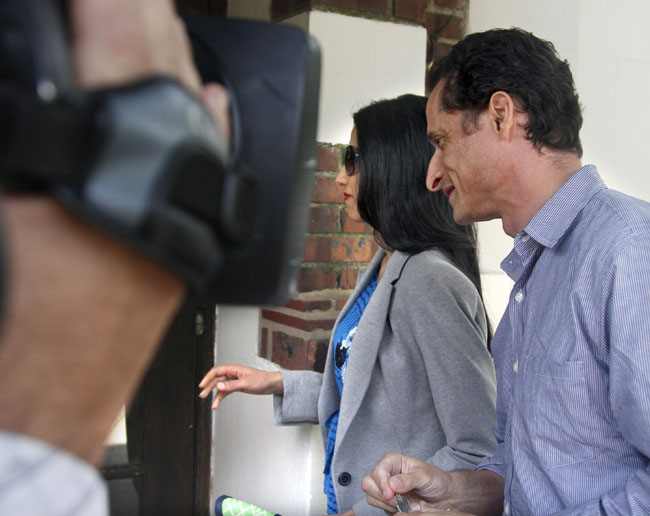 U.S. Rep. Anthony Weiner and his wife, Huma Abedin, arrive at their home in Queens, N.Y., today. He later left alone to go to the news conference where he announced his resignation.