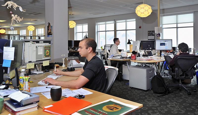 Creative talents at work at Kemp Goldberg, a Portland public relations and advertising firm, are art director Leo Pike, foreground, art director Charlie Jacobsen, center, and Zach Brockhouse, an associate creative director, seen viewing a video produced for a client.