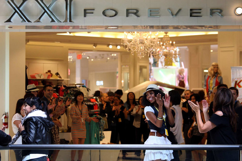 Employees of Forever 21 get into the spirit at the opening of the retailer's 45,000-square-foot store last month in the Beverly Center in Los Angeles. The company is expected to open 70 new stores worldwide this year.