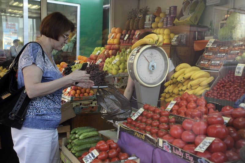 A woman shops at a market in Moscow on Tuesday. An unprecedented outbreak of bacterial infections linked to contaminated produce claimed two more lives in Europe on Tuesday, and Russia banned imports of cucumbers, tomatoes and lettuce.