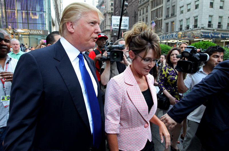 """Former Alaska Gov. Sarah Palin walks with Donald Trump on the way to their scheduled meeting in New York City on Tuesday. """"I'd love her to run"""" for president, he said."""