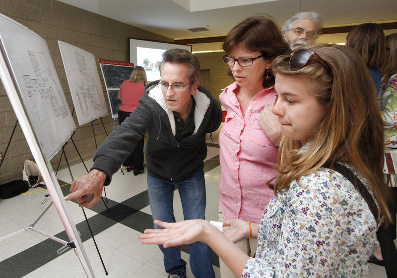 Gaby Ferrell, right, an eighth-grader in South Portland, talks about plans for the renovation and expansion of South Portland High School with her parents, Tim and Courtney Ferrell, during a community open house at the school. Gaby, a member of the building committee, said she's