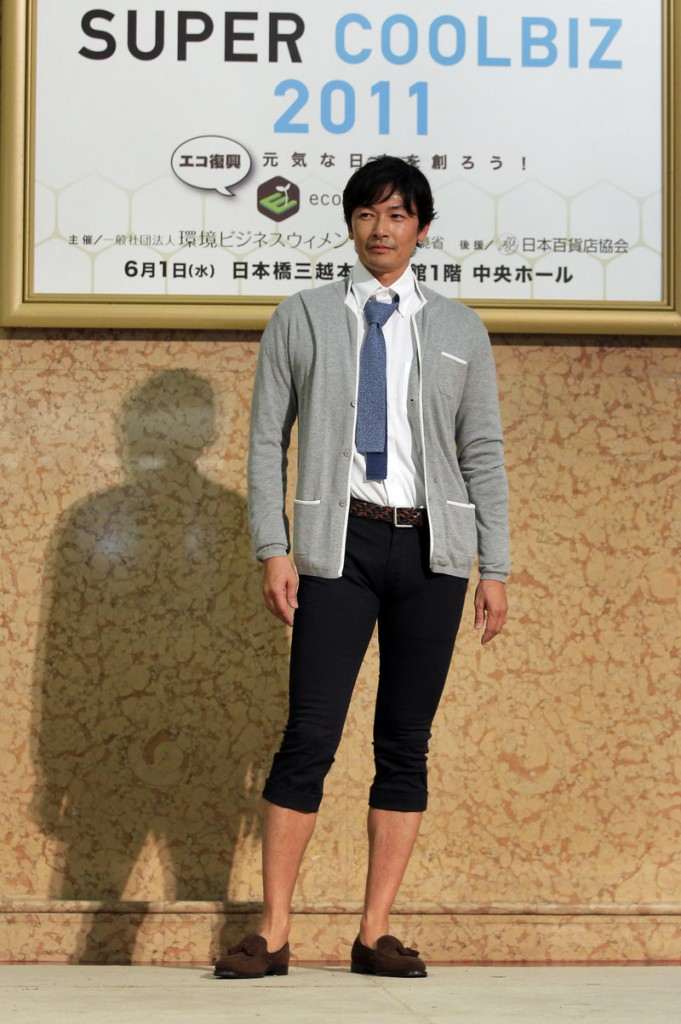 "A model presents a casual office wear outfit featuring pedal pushers during a ""Super Cool Biz"" fashion show in Japan Wednesday."