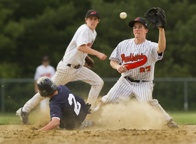 Tom McGuckin of North Yarmouth Academy takes the late throw Wednesday as pinch-runner Davis Brown of Yarmouth slides into second with a stolen base during Yarmouth s 12-4 victory in a regular-season finale.