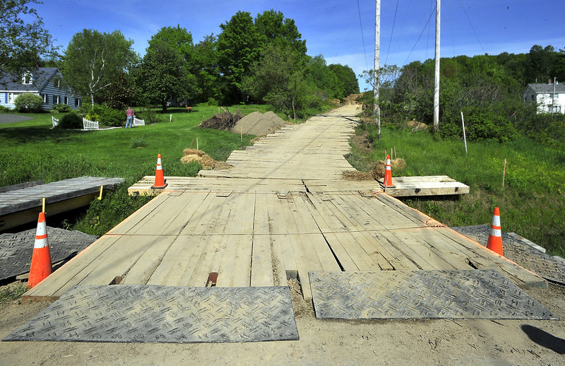 Central Maine Power is using hardwood mats, many made at Bear Hill Lumber in Hollis, to stop soil erosion from heavy machinery and trucks. This one crosses a stream along Leavitt Road in Augusta and leads to an electrical transmission corridor for current repair projects.