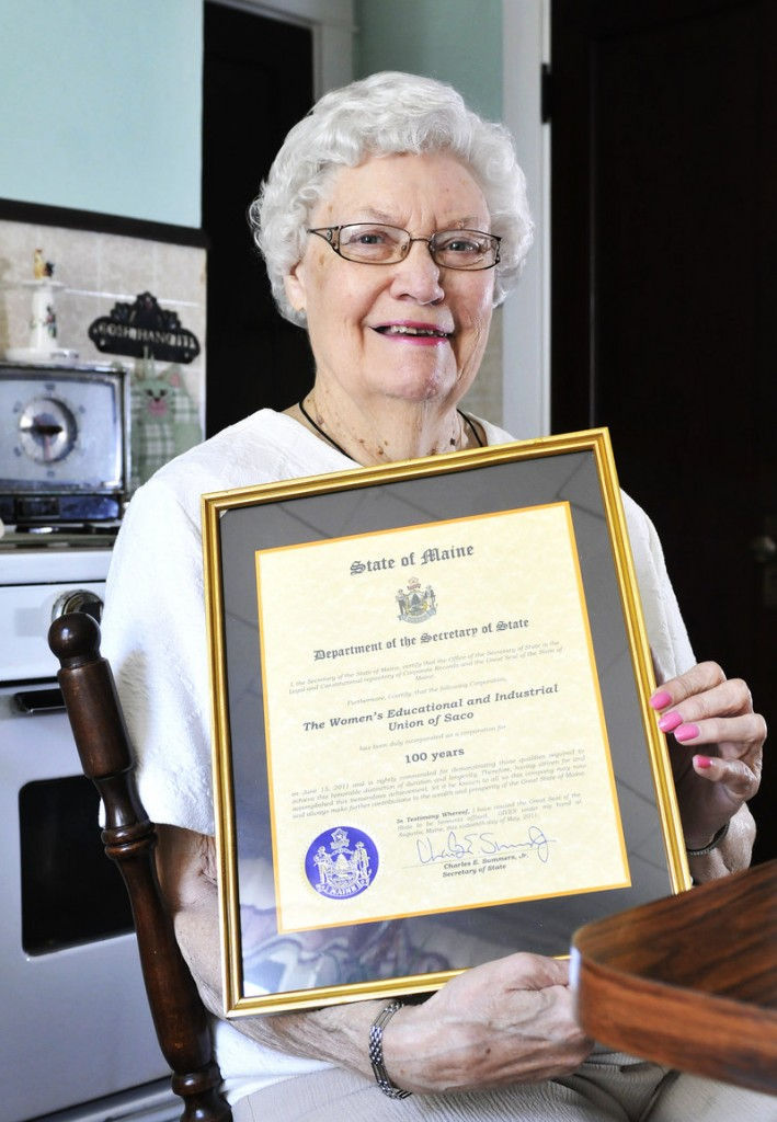 Herberta Harriman holds a plaque marking the 100th anniversary of the Women's Educational and Industrial Union of Saco.