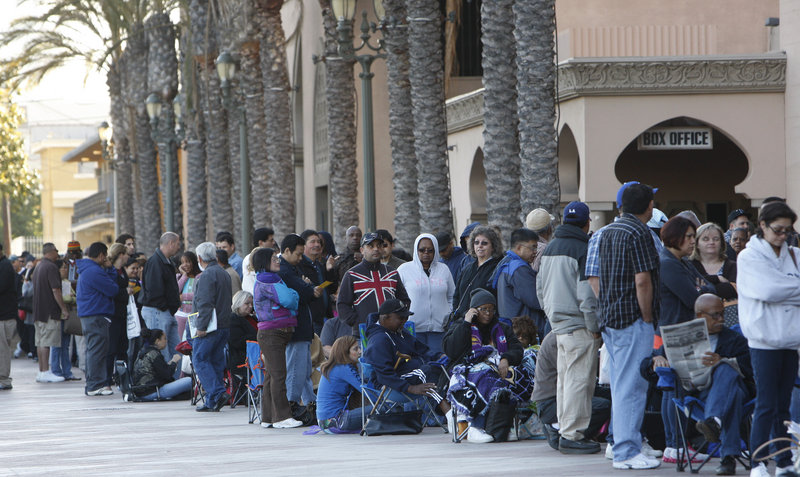 Thousands of homeowners line up Thursday outside the Shrine Auditorium in Los Angeles for help with loan modifications. The Neighborhood Assistance Corporation of America has been touring several U.S. cities in the past year, offering free loan modification assistance.