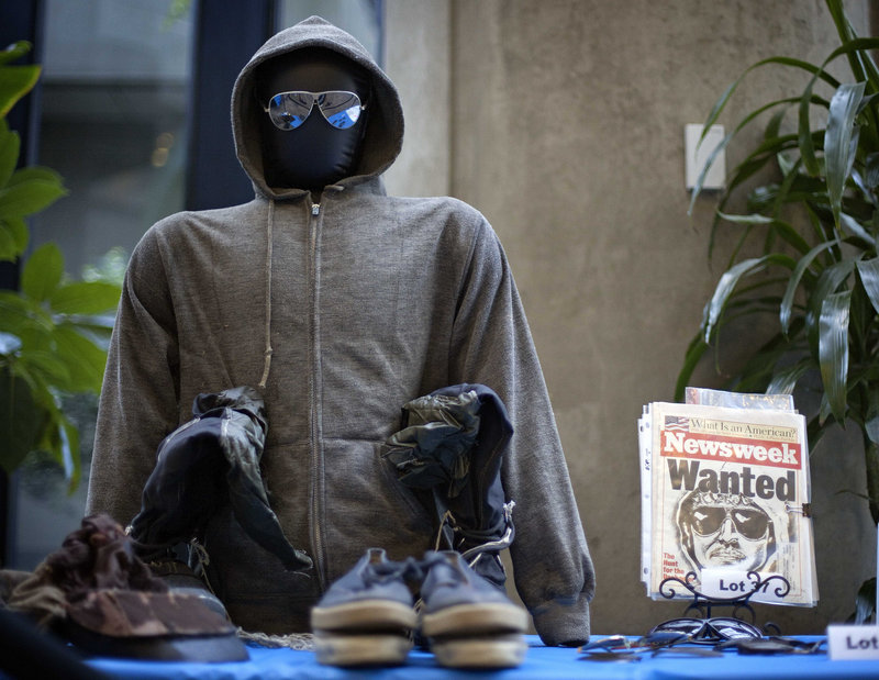 The hooded sweat shirt and sunglasses worn by Ted Kaczynski, also known as the Unabomber, are displayed among his personal items auctioned off online Thursday.