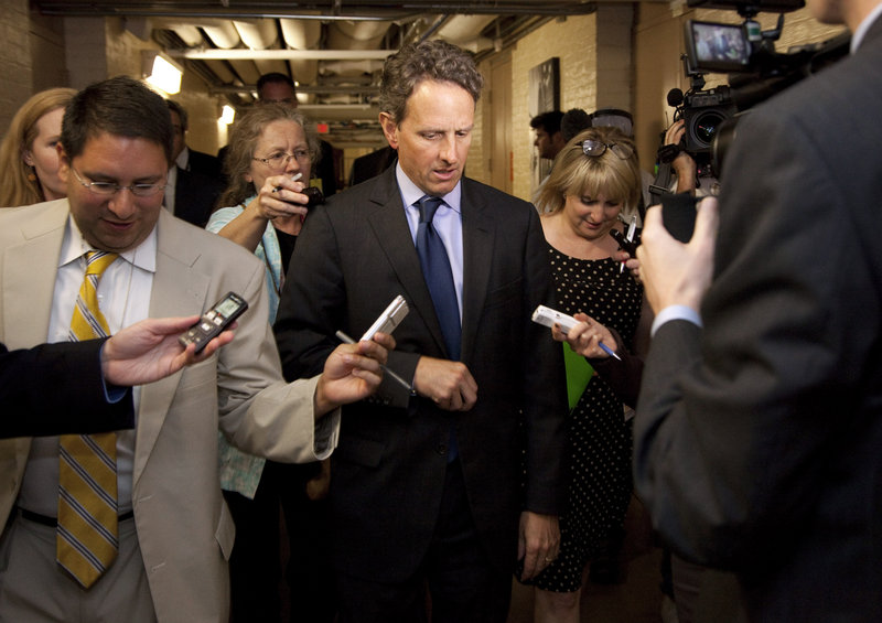 Treasury Secretary Timothy Geithner is followed by reporters after meeting with GOP House freshmen on Capitol Hill Thursday in Washington. Some Republicans say Geithner's predictions of an economic disaster linked to the debt ceiling are meant to force a deal with GOP leaders.