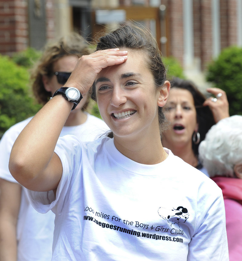Zoe Romano reacts as Portland High School students line the front of PHS to welcome her after her ceremonial run Friday.