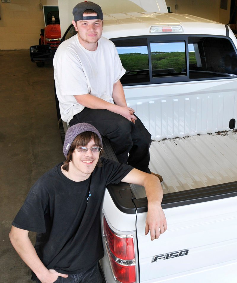 Anthony Perron of Scarborough, top, and Joshua Beeler of Raymond will arrive at the national student auto skills competition in Michigan next week with no tools of their own – just a laptop and a DVD with protocols for repairing a 2011 Ford F150.