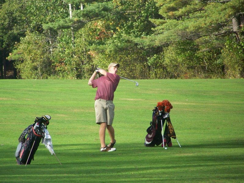 Mike Arsenault shot a 72 in harsh weather to win the individual title, then he led Gorham to the Class A team title.