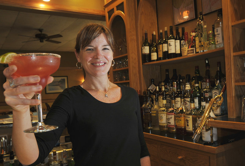 Sarah Lane, one of the owners of Lucas on 9, serves up a black raspberry margarita.