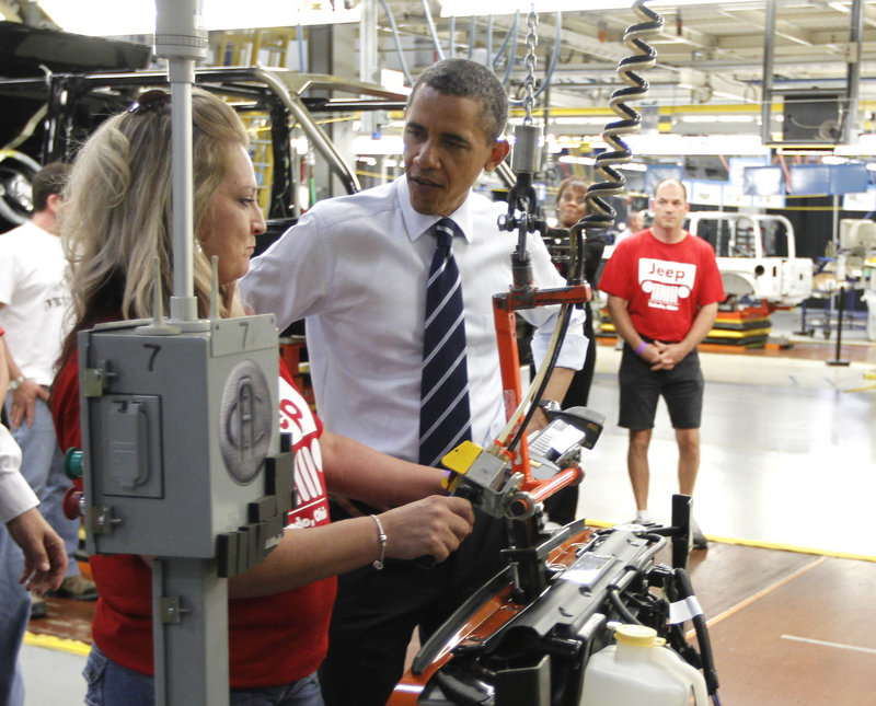 """President Obama tours Chrysler Group's Toledo Supplier Park in Toledo, Ohio, on Friday. """"Thank you for bailing out Chrysler,"""" one woman told the president as he shook workers' hands during a shift change."""