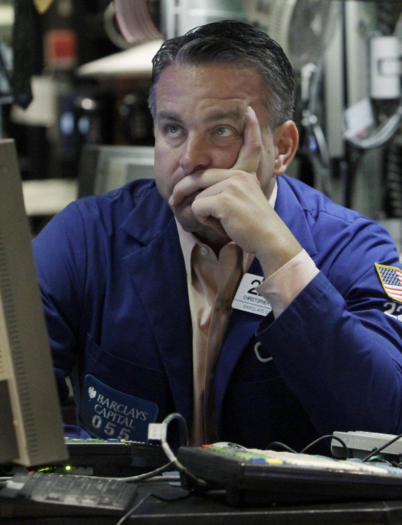 Christopher Culhane works at his post on the floor of the New York Stock Exchange Friday.