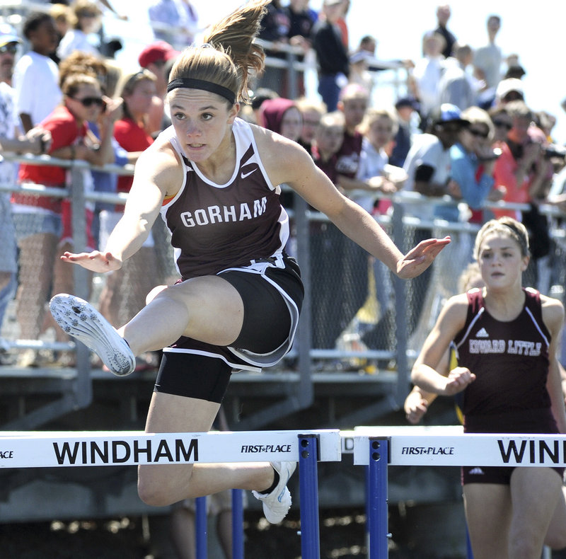 Sarah Perkins of Gorham wins a preliminary heat of the 100-meter hurdles Saturday at the Class A championships Saturday in Windham. Perkins went on to win the final in 15.52 seconds.