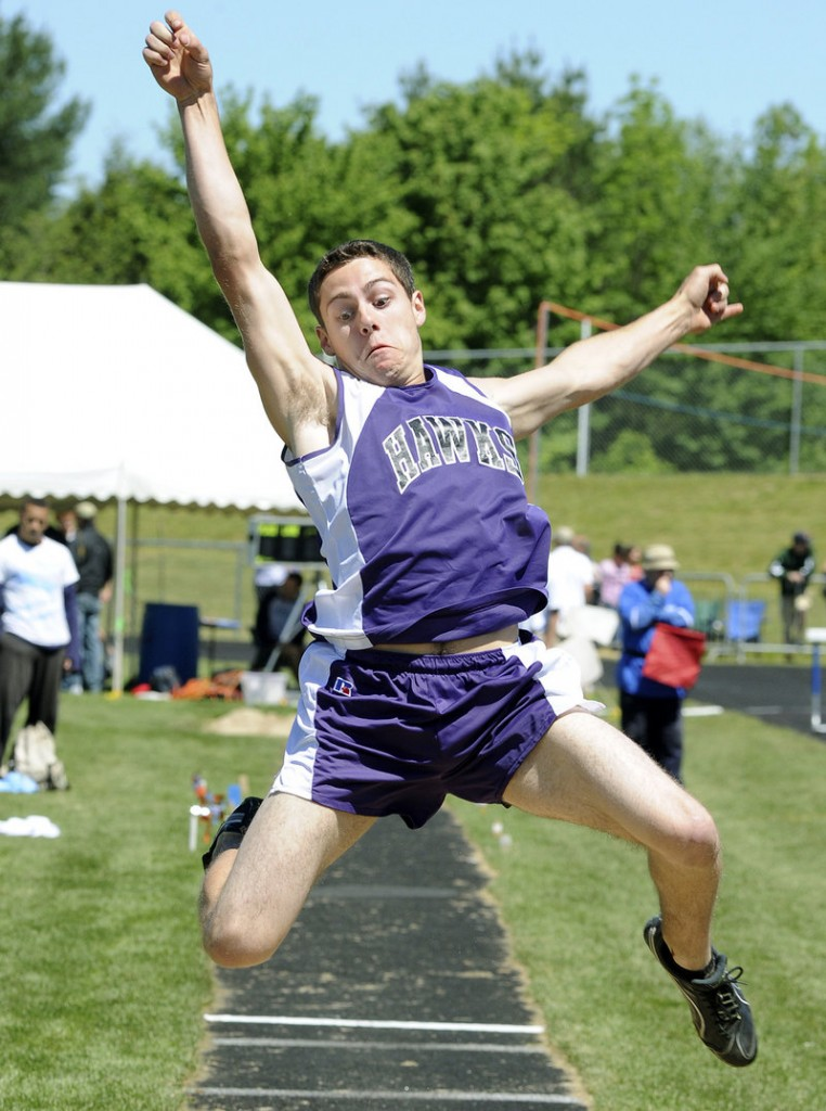 Marshwood's David Mick stretches out for a long jump of 19 feet, 3 3⁄4 inches Saturday during the Class A state championships at Windham High. Sanford's Alex Shain won the event with a jump of 21-2.