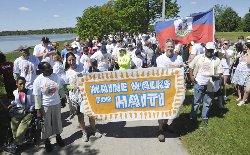 Walkers get set to walk around Back Cove as part of Maine Walks for Haiti, a fundraising event to benefit the Konbit Sante Cap-Haitien Health Partnership on Saturday. Holding the sign out front are Lisa Merchant and John Shoos, who serves on the board for Konbit Sante.