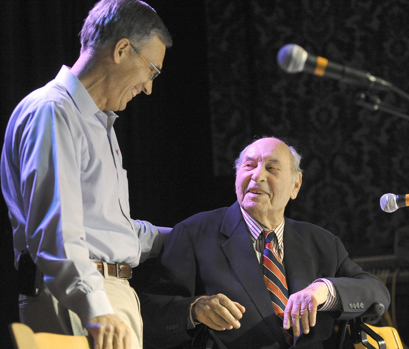 Former U.S. Rep. Tom Allen visits with guest of honor Dave Astor during