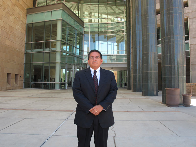 Federal defender Saul Huerta, shown outside the Evo A. DeConcini Federal Courthouse in Tucson, Ariz., has challenged Operation Streamline's legality, and calls it a separate and unequal criminal justice system.