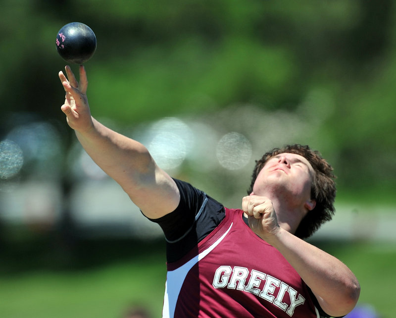 Jack Fellows of Greely gives it his all in the Class B shot put. Fellows' best throw gave him a runner-up finish to teammate Michael Burgess.