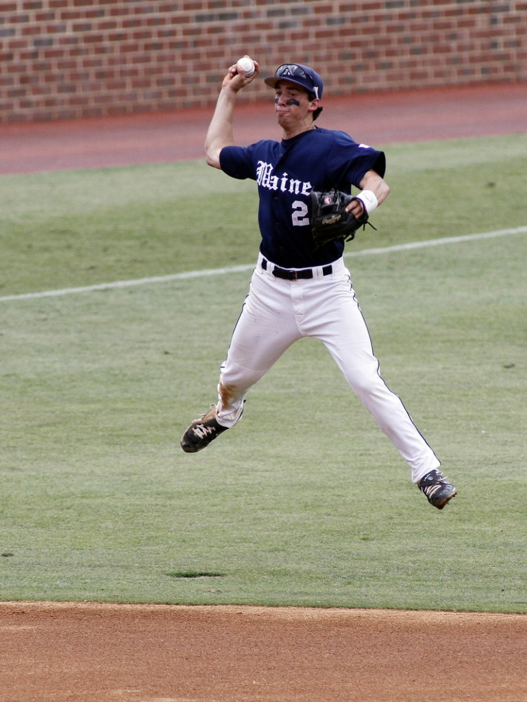 Maine's Michael Fransoso leaps and throws during the first inning against James Madison on Sunday in the Chapel Hill Regional at Chapel Hill, N.C.