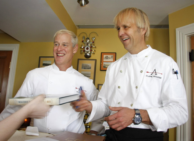 Chefs Mark Gaier and Clark Frasier sign copies of their new cookbook,