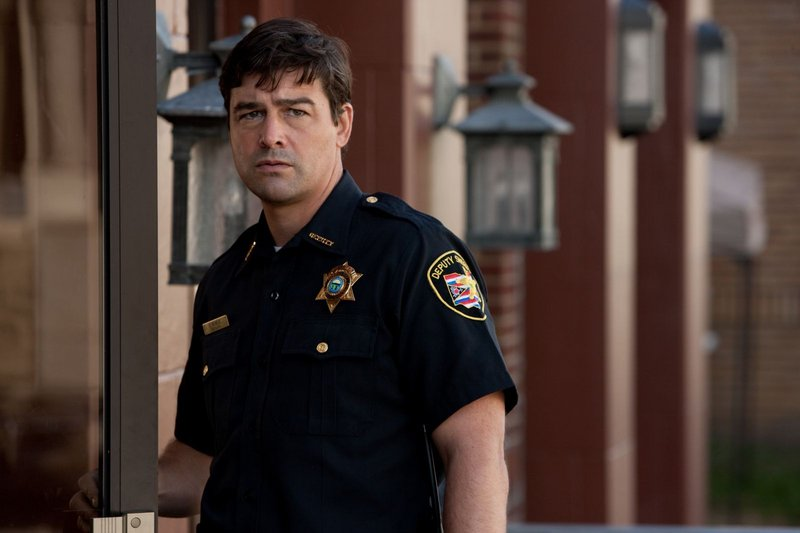 Kyle Chandler is a deputy sheriff struggling to care for a son (played by Joel Courtney) he doesn't known very well.