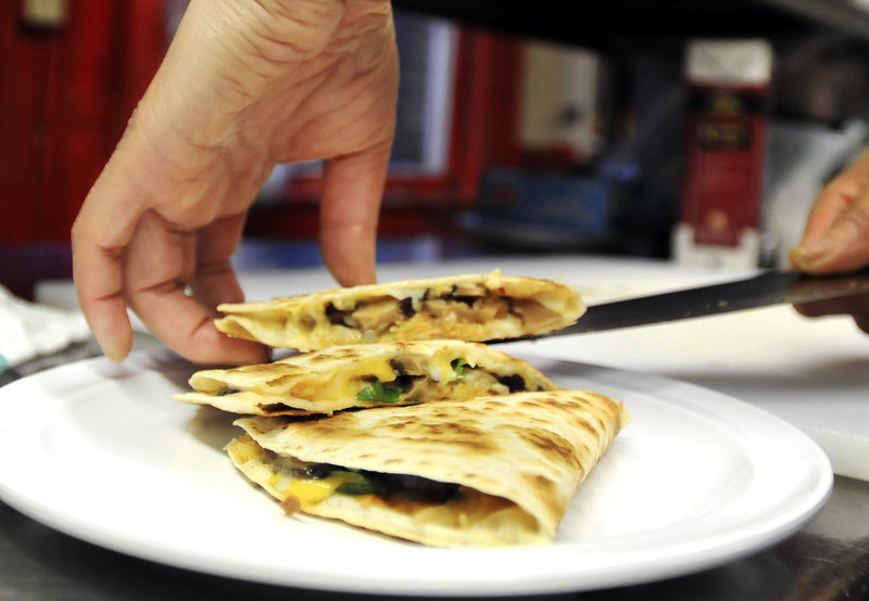 Hwamin Yi, co-owner of Gogi, plates a shiitake mushroom quesadilla.