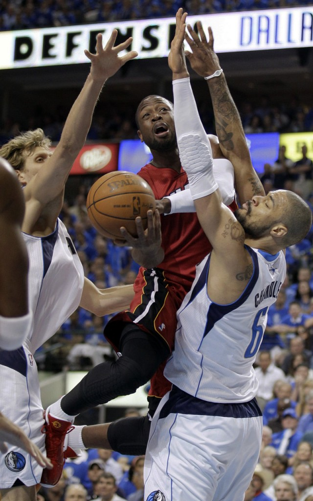 It's been a common sight in the NBA finals: Miami's Dwyane Wade slicing through or soaring over Dallas defenders for two points. On a talent-laden team, he's looking like the MVP.