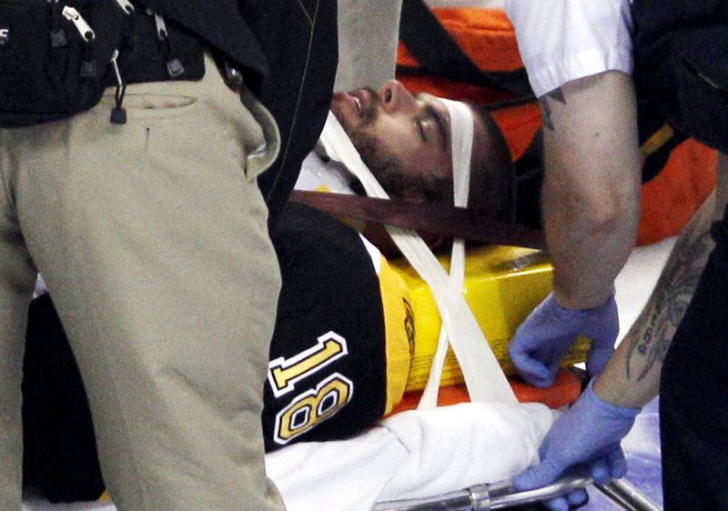 Nathan Horton is placed on a stretcher after Aaron Rome's hit and is taken to a hospital. It was later reported Horton was moving his arms and legs.