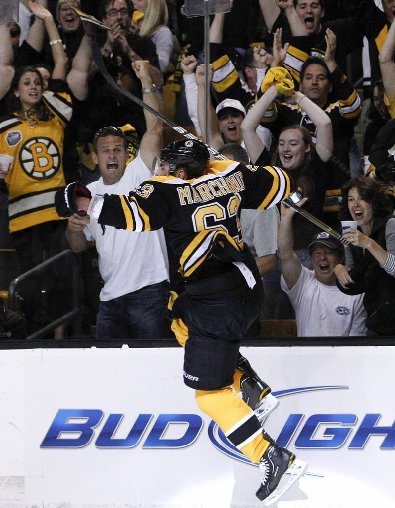 Brad Marchand reacts after scoring a short-handed goal for a 3-0 lead against Vancouver on Monday night. Boston built a 5-0 lead on the way to an 8-1 victory in Game 3 of the Stanley Cup finals. Vancouver leads, 2-1.
