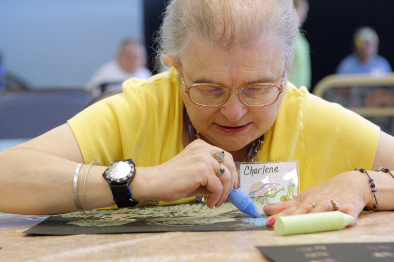 Charlene Gardner works on a drawing at the Truslow Adult Day Center in Saco on Monday. The center charges $14 an hour, which is sometimes reduced or covered by insurance plans.