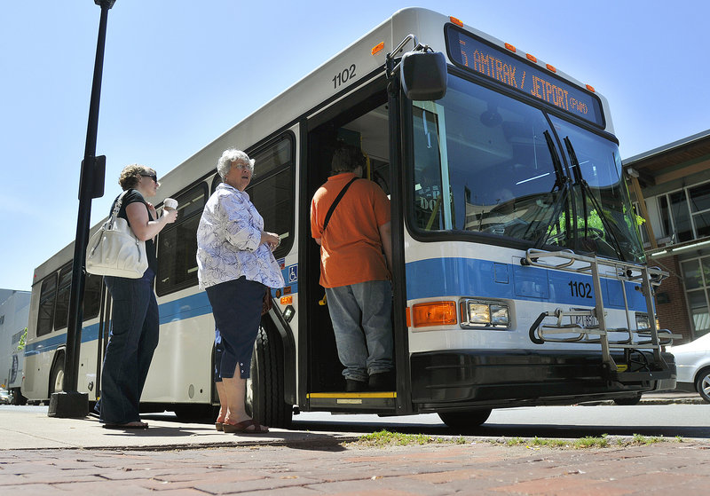 Passengers board a new Metro bus Wednesday on Elm Street in Portland. Most of the funding for the clean-diesel buses came from the federal stimulus package.