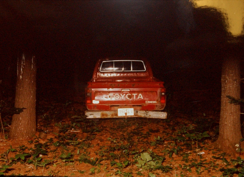 A police photo of Dennis Dechaine's pickup truck taken on July 6, 1988, the day Sarah Cherry disappeared. The truck was found near where Cherry's body was discovered.