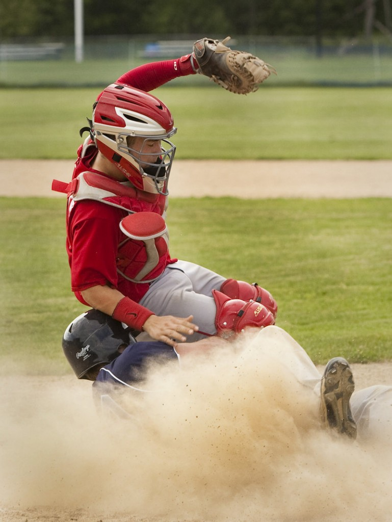York's Ryan Schoff slides home safely as Gray-New Gloucester catcher Tim Lerette tumbles in. The play tied the score at 1 in their Western Class B preliminary-round baseball game Tuesday in Gray.