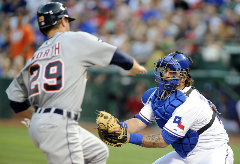 Texas' Mike Napoli waits to put a tag on Detroit's Danny Worth on Tuesday in Arlington, Texas. The Rangers won, 8-1.