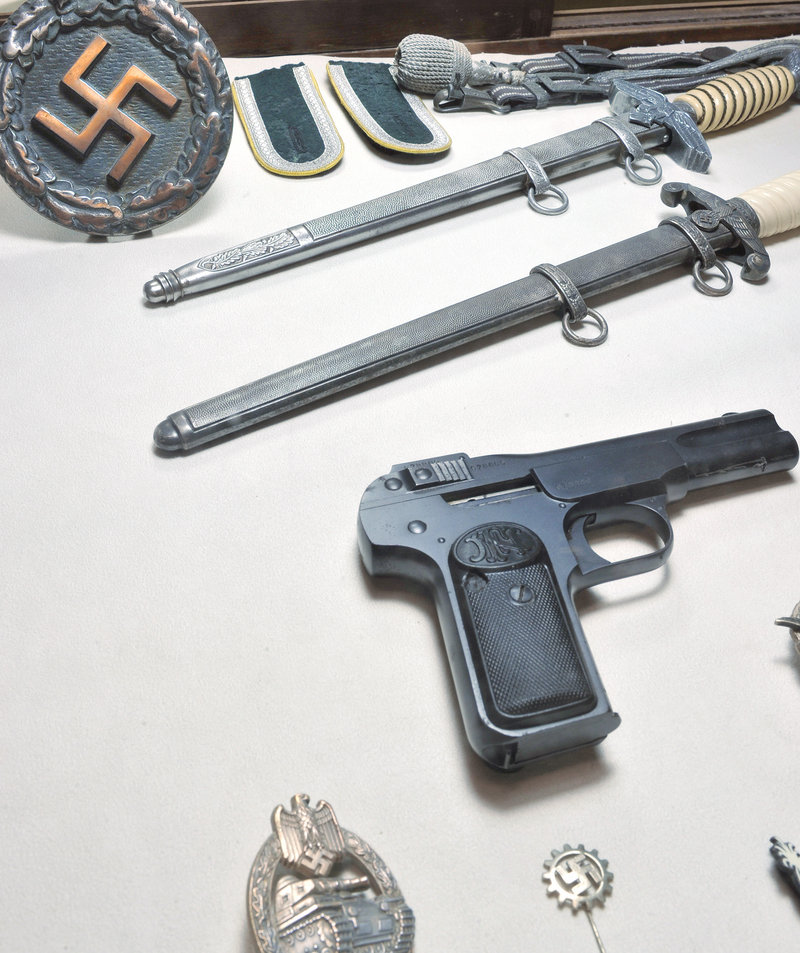 World War II weapons and insignia are displayed at the new museum.