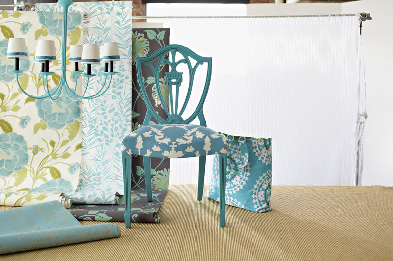 Vibrant turquoise paint brightens an old chandelier and chair. New shades and fabric finish the job.